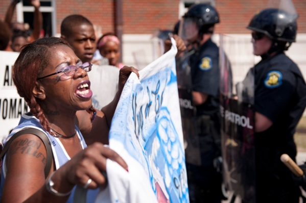 Marcelle Stewart confronts police officers during a march and rally in downtown Ferguson, Mo., Aug. 11, 2014. (Credit: AP/Sid Hastings)