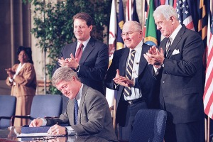 Bill Clinton signing NAFTA, the first disaster He's no Huckleberry
